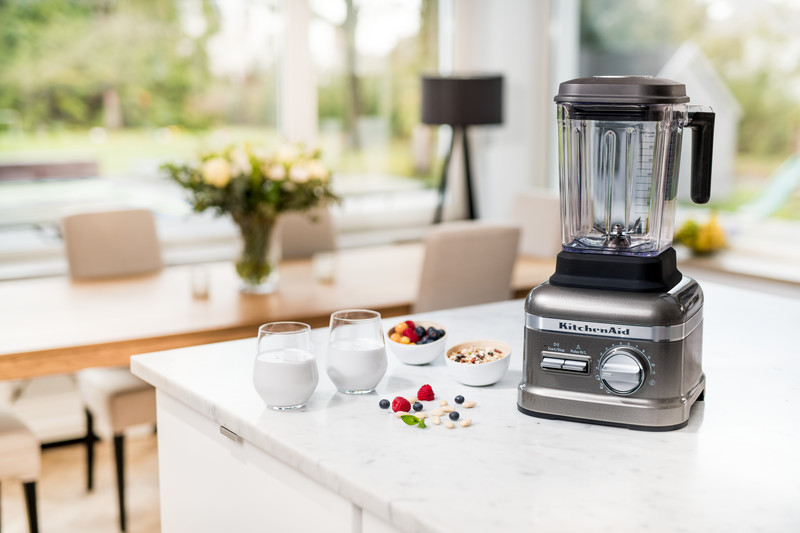 Grey blender with yoghurt and fruits