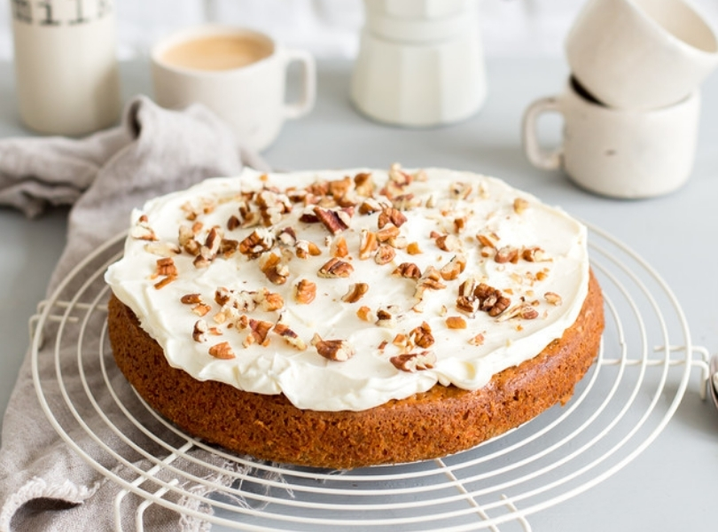 Carrot cake with frosting and walnuts