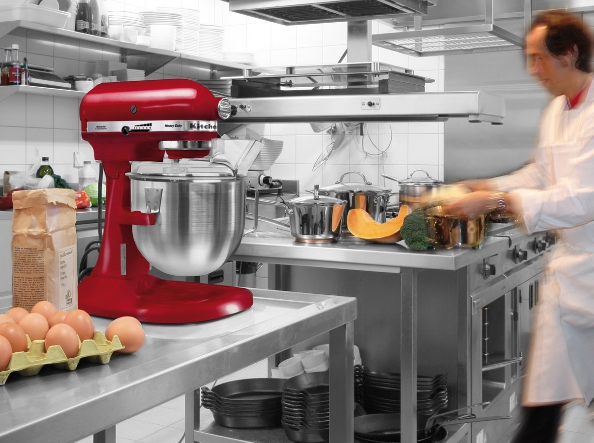 Red mixer bowl lift in professional kitchen