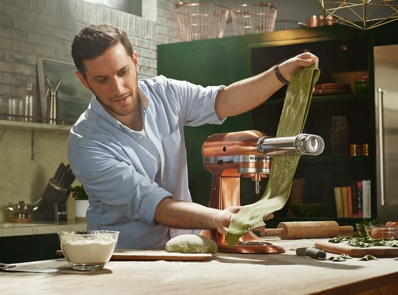 Copper mixer rolling green pasta sheet