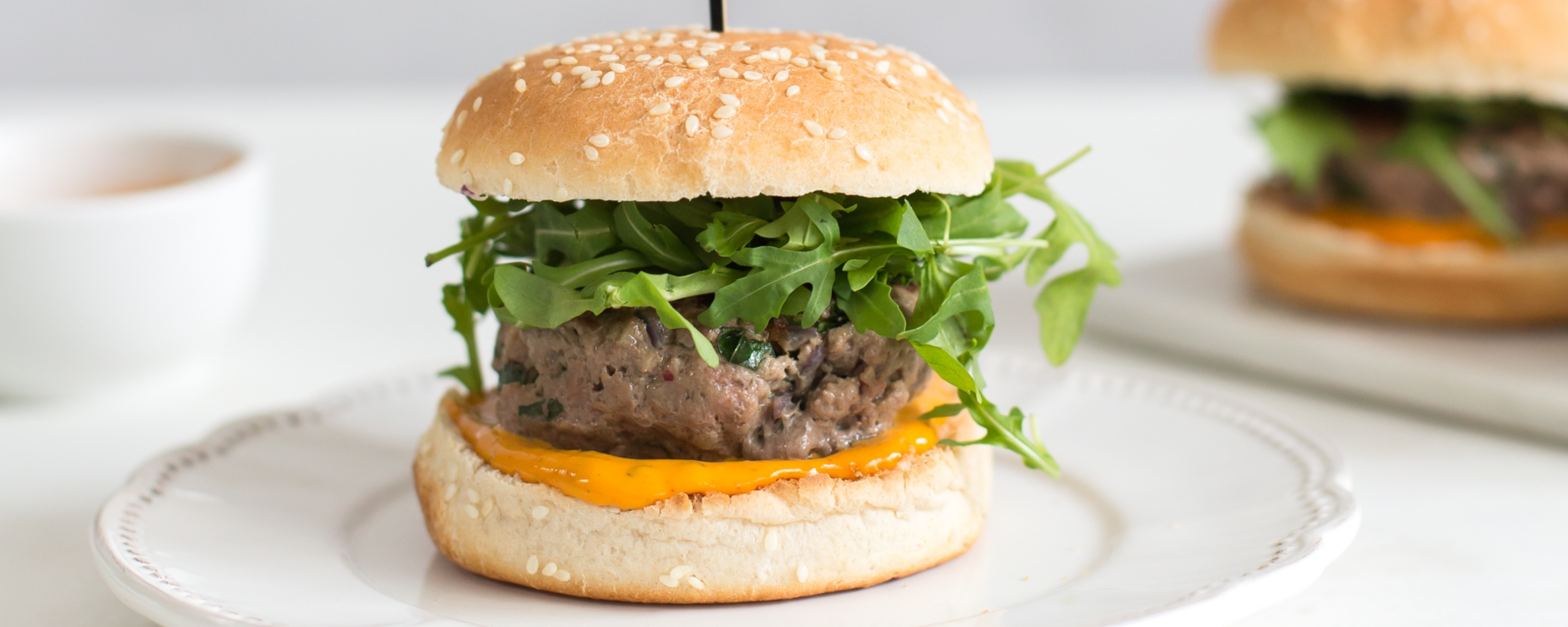 Homemade burger with cheese and rucola