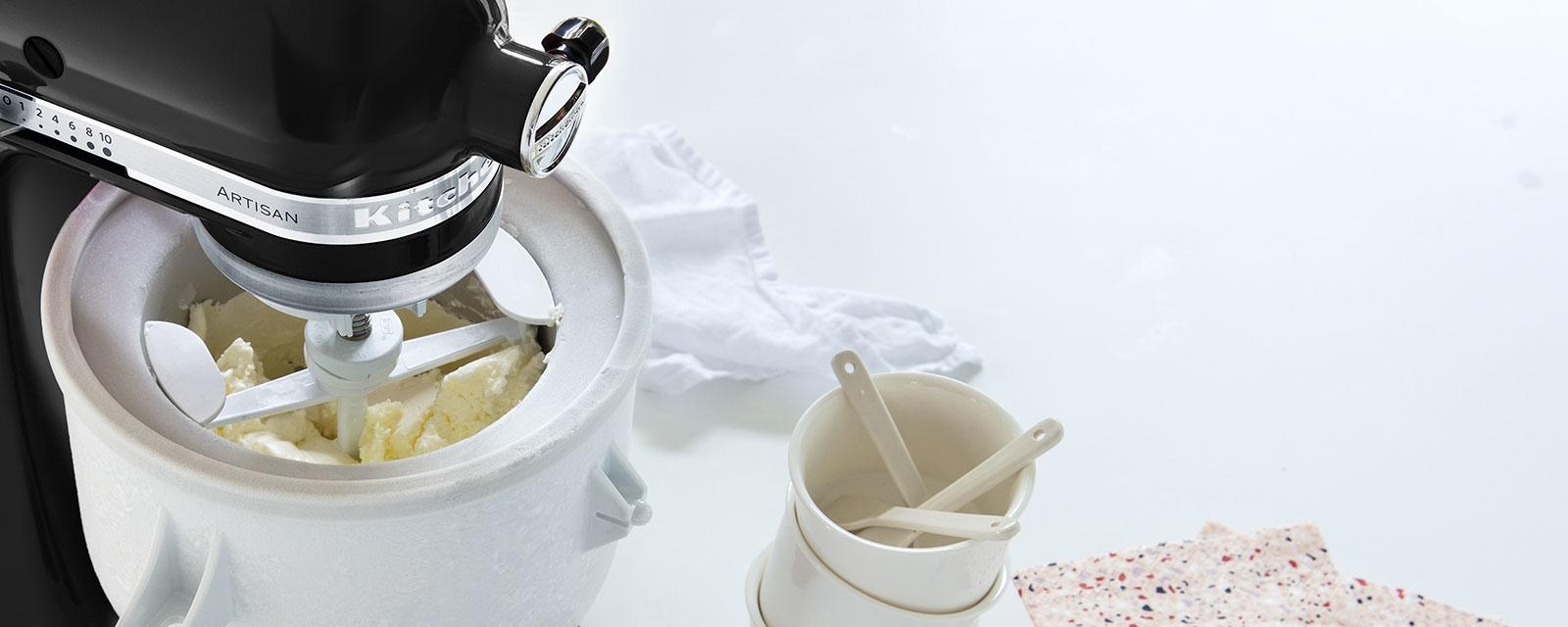 Ice cream maker on black mixer making vanilla ice cream