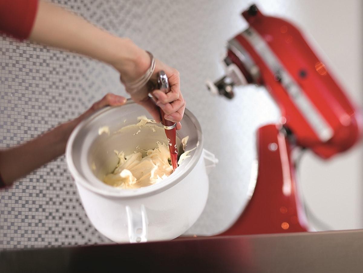 Blue ceramic mixing bowl on grey mixer and lemon pie