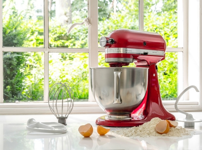 Red mixer with whisk dough hook and paddle attachment