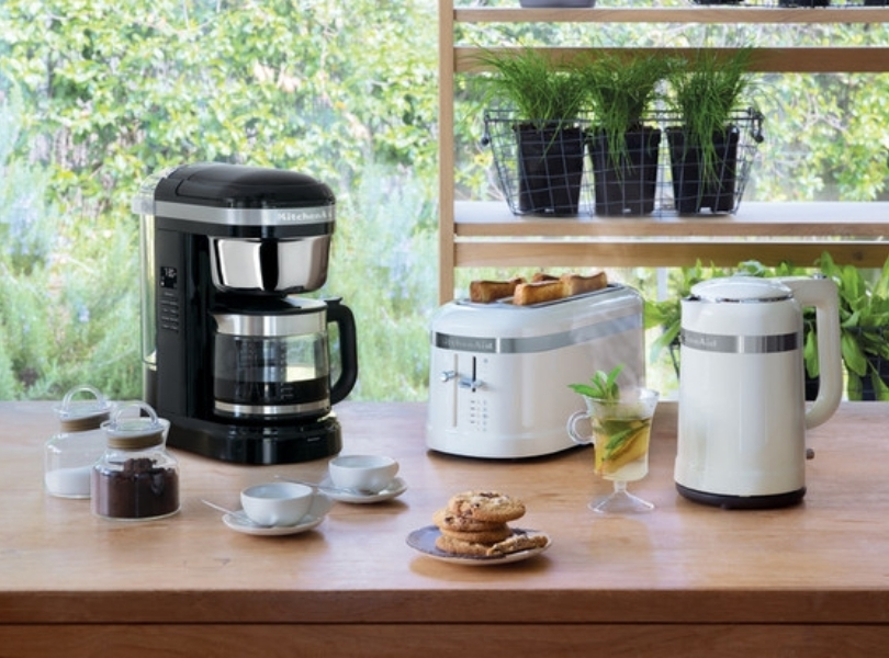 Black drip coffee maker with white kettle and toaster