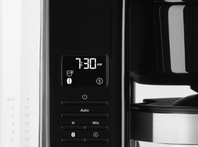 Zoom on control panel of black filter coffee machine