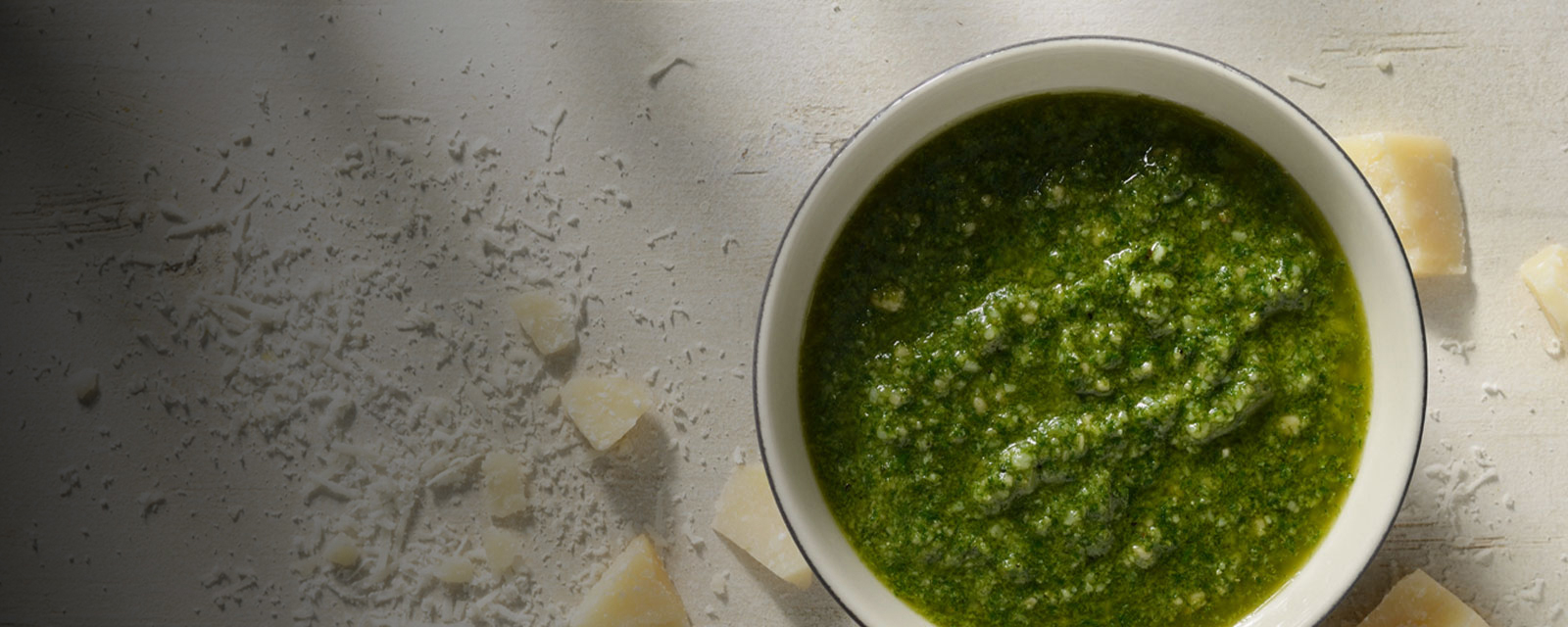 Green pesto sauce with parmesan cheese
