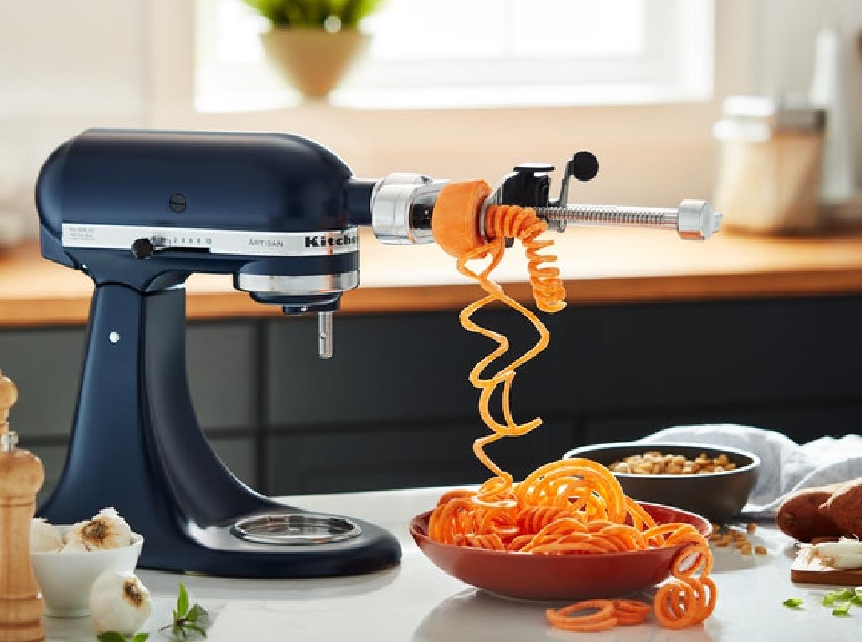 Dark blue mixer spiralizing carrots