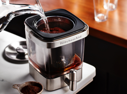 Filling cold brew coffee maker with water