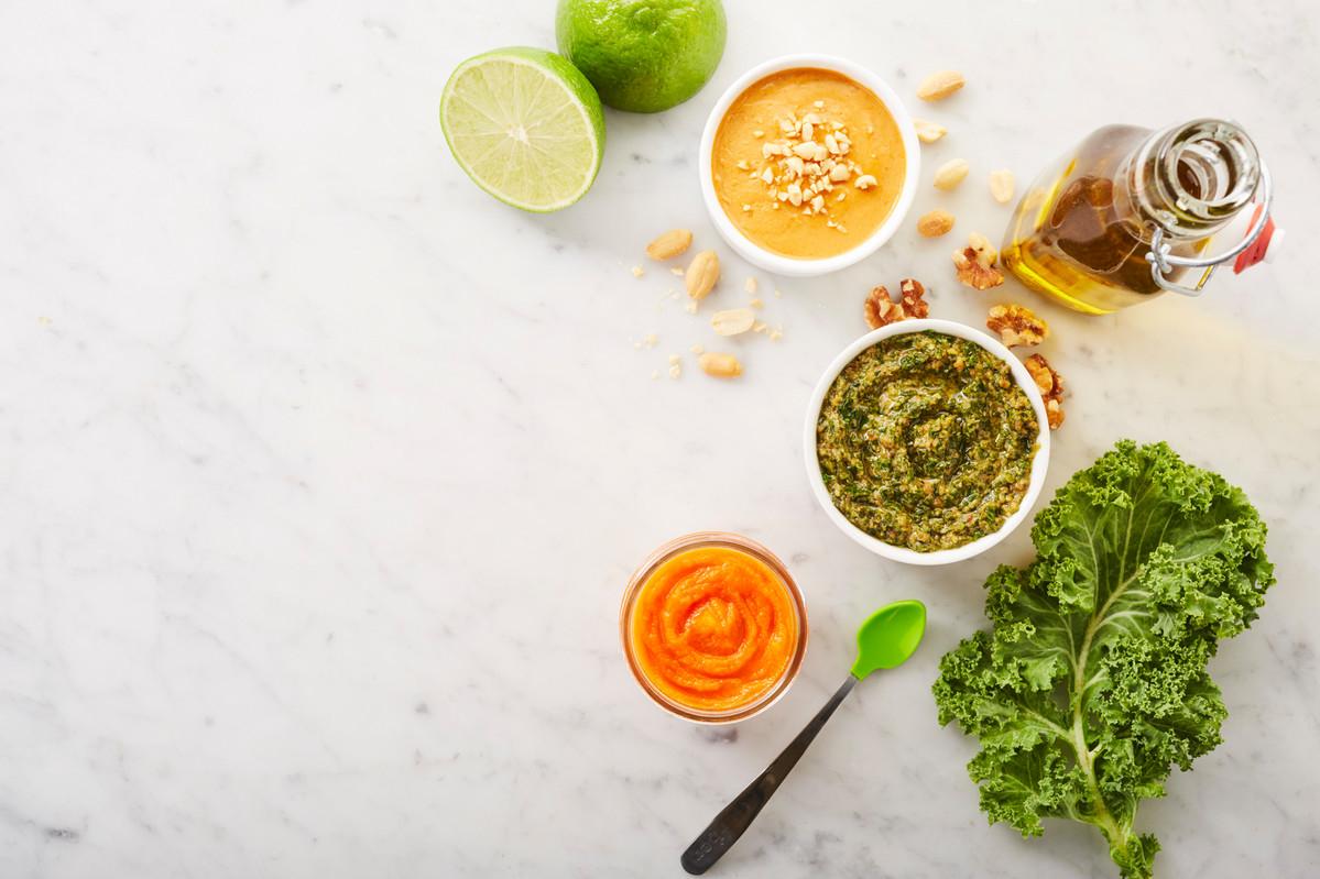 Carrots kale purée and pumpkin soup on marble table