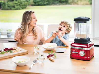 mother-and-son-laughin-next-to-a-red-soup-blender