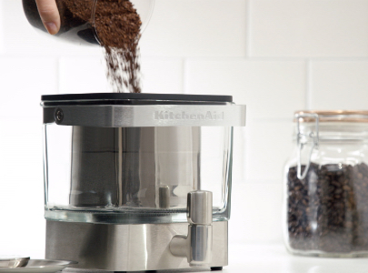 Adding coffee in cold brew coffee maker
