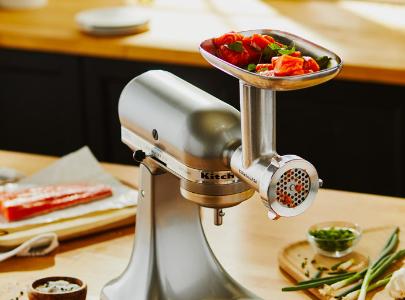 Food grinder grinding vegetables