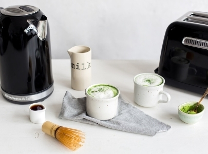 Black kettle and toaster with matcha latte