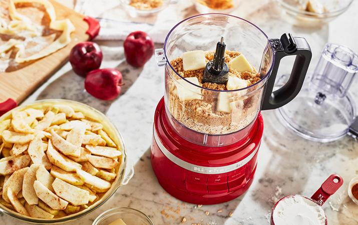 Preparing apple pie with red food processor