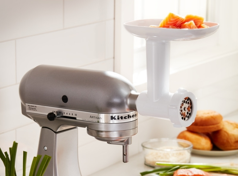 Meat grinder grinding salmon