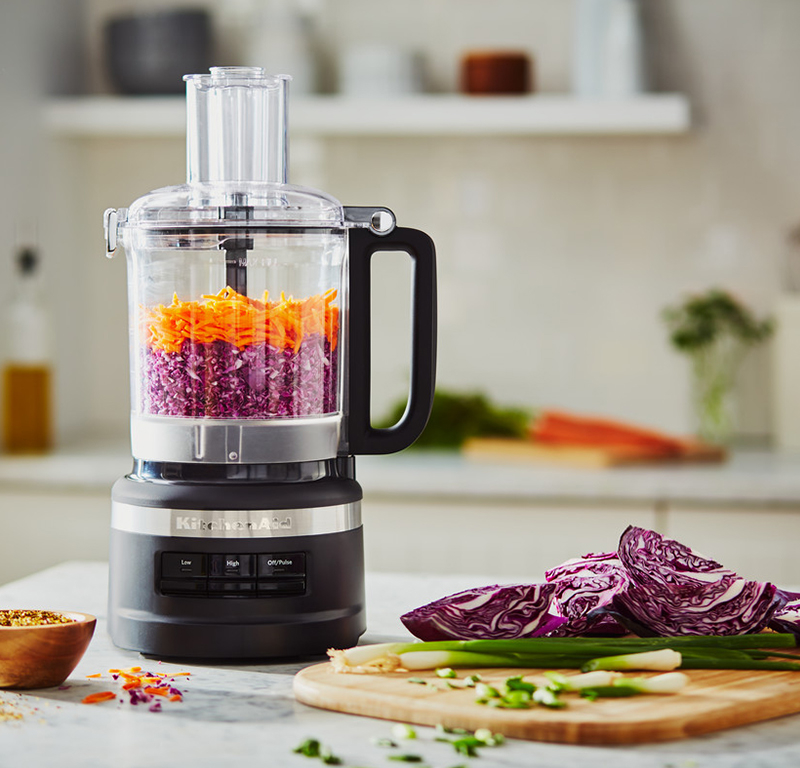 Shredding vegetables in black food processor