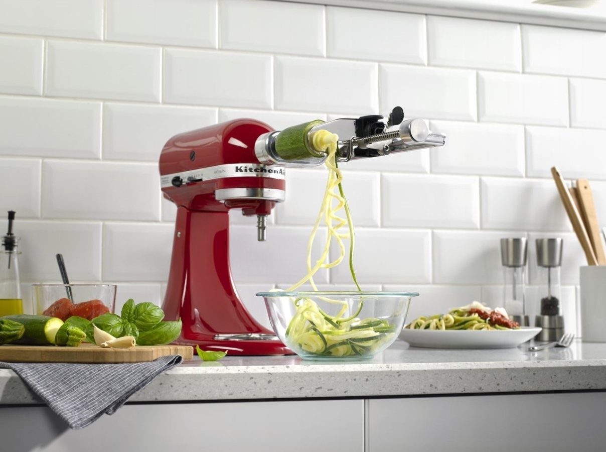 Red mixer making spaghetti of courgette with spiralizer