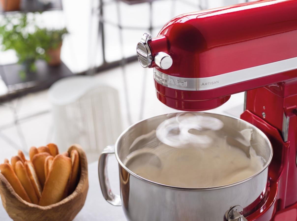 Red mixer beating egg whites