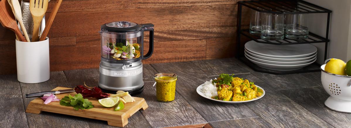 Grey mini food chopper mixing curry sauce