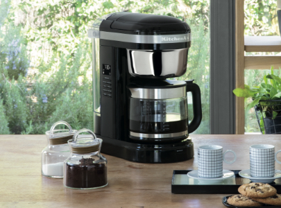 Black filter coffee machine with cookies